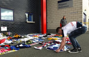 Muamba get well messages: A Bolton Wanderers supporter lays a message outside the Reebok Stadium