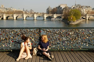 Spring: young women sit on the Pont des Arts