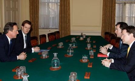 George Osborne, David  Cameron and Nick Clegg at a budget meeting