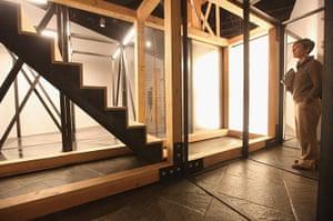 "Whitney Biennial: A visitor views Oscar Tuazon's ""For Hire"" (2012) mixed media piece"