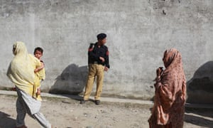 Neighbours passing the compound in Abbottabad where Osama bin Laden was killed by US military forces