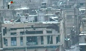 Video footage shown on Syria TV is said to show damaged buildings in Baba Amr