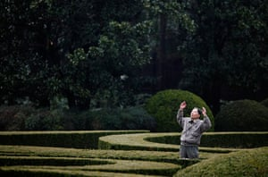24 hours in pictures: Shanghai, China: An elderly man exercises at a park