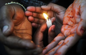 24 hours in pictures: Kolkata, India: Women's rights activists hold candles