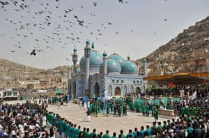 24 hours in pictures: Kabul, Afghanistan: People gather for a new year ceremony
