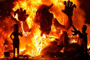 24 hours in pictures: Valencia, Spain: Effigies burn during the finale of the Fallas festival