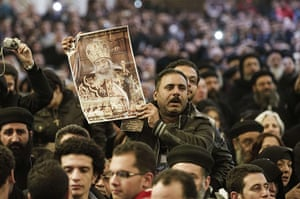 Pope Shenouda Funeral: An Egyptian Coptic Christian holds a portrait of Pope Shenuda
