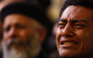 Pope Shenouda Funeral: Egyptian Christian reacts during the funeral of Pope Shenouda