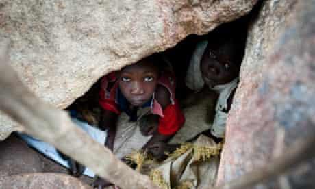 Nuba children take cover in caves