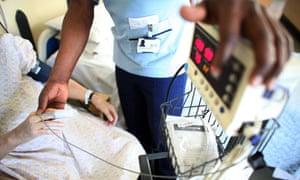 NHS nurse tending to patient