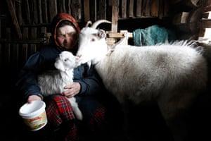 Russia's Eurovision: Ekaterina Shklyaeva, 74, feeds a goat at her home in Buranovo