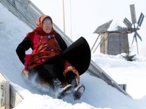 Russia's Eurovision: Galina Konyeva, 74, slides down an ice slide at a folk museum