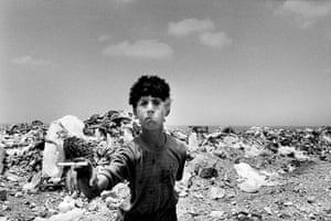 Sean Smith open weekend: Boy scavenging from rubbish tip near the Green Line, Beirut, Lebanon, 1997