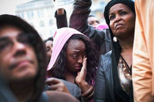 Trayvon Martin march: A woman wipes away a tear during the protest