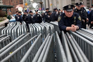 Trayvon Martin march: A police officer waits by barricades as the protest begins