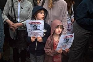 Trayvon Martin march: Boys hold images of slain Florida teen Trayvon Martin