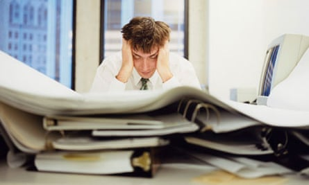 man at desk studying documents