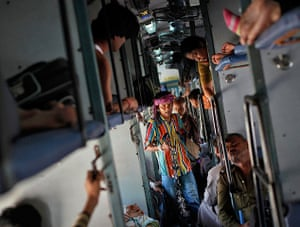 24 hours: India: A man sells locks and chains inside the Kalka Mail passenger train