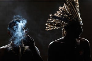 24 hours: IBrasilia, Brazil: An indigenous man smokes during a protest