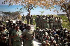 24 hours: Port-au-Prince, Haiti: Members of the dissolved Haitian army parade