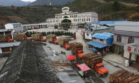 Burmese trucks carrying timber