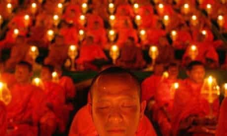 Thai Buddhist monks recite prayers