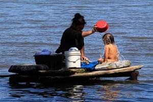 World Water Day: A woman bathes her son at Lake Cocibolca