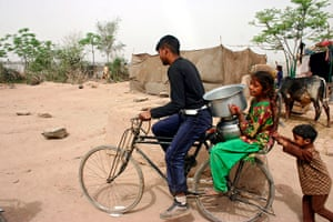 World Water Day: Pakistani carry water in Lahore,