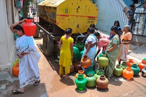 World Water Day: Indian women fill containers with drinking water