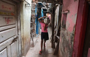 World Water Day: An Indian boy carries a stainless steel pot filled with drinking water