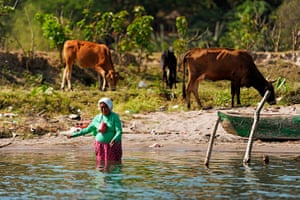World Water Day: A woman fishes in the ILopango Lake