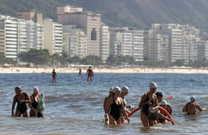 World Water Day: Residents collect garbage on Copacabana beach in Rio de Janeiro