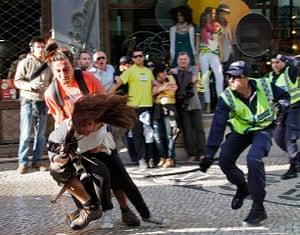 Patricia Melo: A policeman strikes AFP photojournalist Patricia Melo
