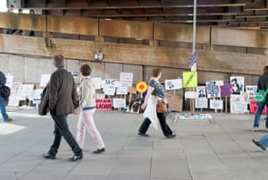 Placard gallery: Passersby at the exhibition space