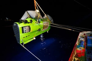 Deepsea: The Deepsea Challenger submersible is hoisted into the Pacific Ocean.