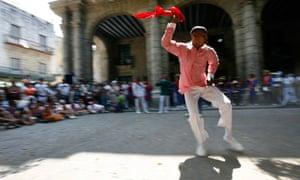 A dancer of the Afro-Cuban Santeria religion performs at Havana's Plaza de Armas square