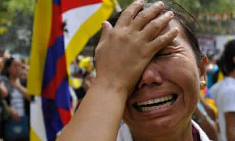 Tibetan woman cries