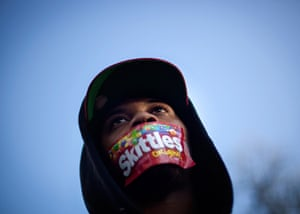 Trayvon Martin marches: Jajuan Kelley wears a Skittles wrapper over his mouth