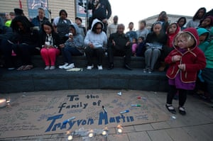 Trayvon Martin marches: People light candles and write messages during a vigil in Washington