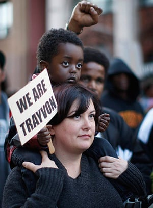 Trayvon Martin marches: A woman carries a child during the Million Hoodies March in Los Angeles