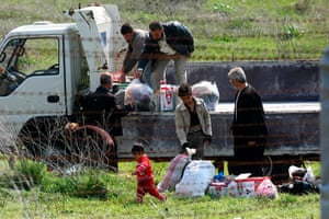 Syrian Refugees: Syrian refugees look  through a barbed wire fence
