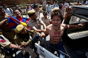 Tibet Protests: A Tibetan exile is detained by Indian police