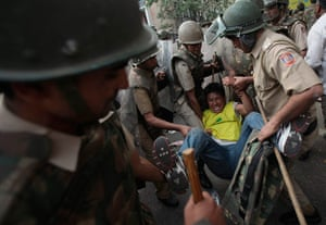 Tibet Protests: Policemen detain a Tibetan exile during a protest