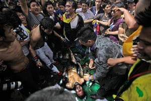 Tibet Protests: Jampa Yeshi lies on the ground after he lit himself on fire
