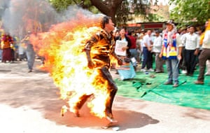 Tibet Protests: Tibetan exile Jampa Yeshi runs after setting himself on fire