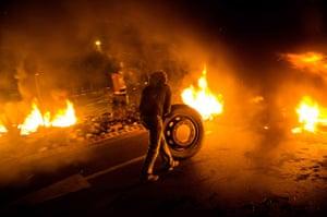 Spain strikes: Barcelona: A barricade of burning tyres