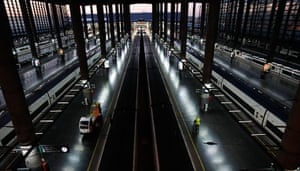 Spain strikes: Madrid: A worker walks past AVE high-speed trains at Atocha station