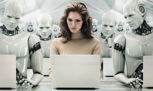 A woman works on a laptop surrounded by watching androids