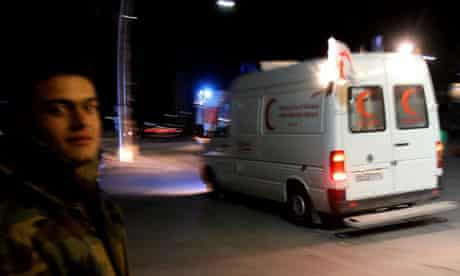 An ambulance believed to be carrying remains of journalist Marie Colvin and photographer Remi Ochlik