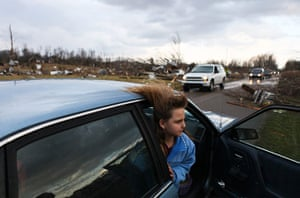 Tornado Updated: Janessa Lewellyn looks at her grandparents house after a tornado in Indiana
